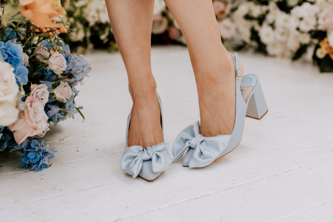 """<a href=""""https://charlottemills.com/collections/wedding-shoes/products/jill-pale-blue-bow"""" target=""""_blank"""" rel=""""noopener noreferrer"""">Jill Pale Blue by Charlotte Mills</a> £260"""