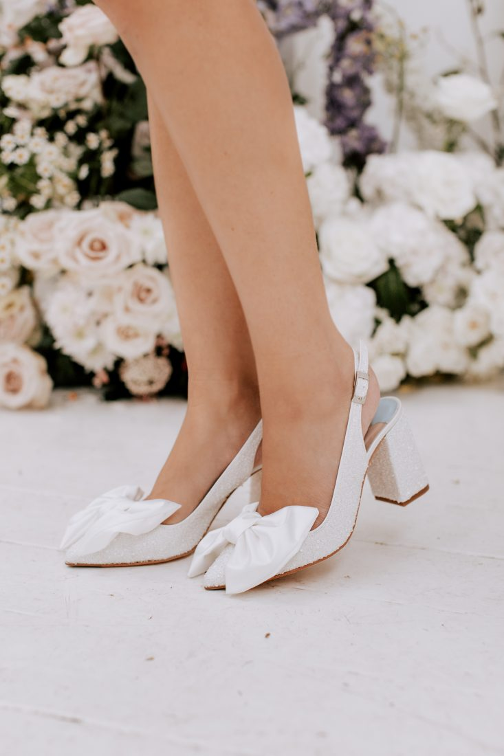 """<a href=""""https://charlottemills.com/collections/wedding-shoes/products/jill-pearl"""" target=""""_blank"""" rel=""""noopener noreferrer"""">Jill Pearl Bow by Charlotte Mills</a> £265"""