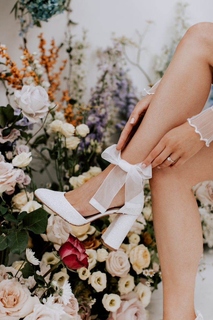 """<a href=""""https://charlottemills.com/collections/wedding-shoes/products/juniper-pearl"""" target=""""_blank"""" rel=""""noopener noreferrer"""">Juniper Pearl by Charlotte Mills</a> £235"""