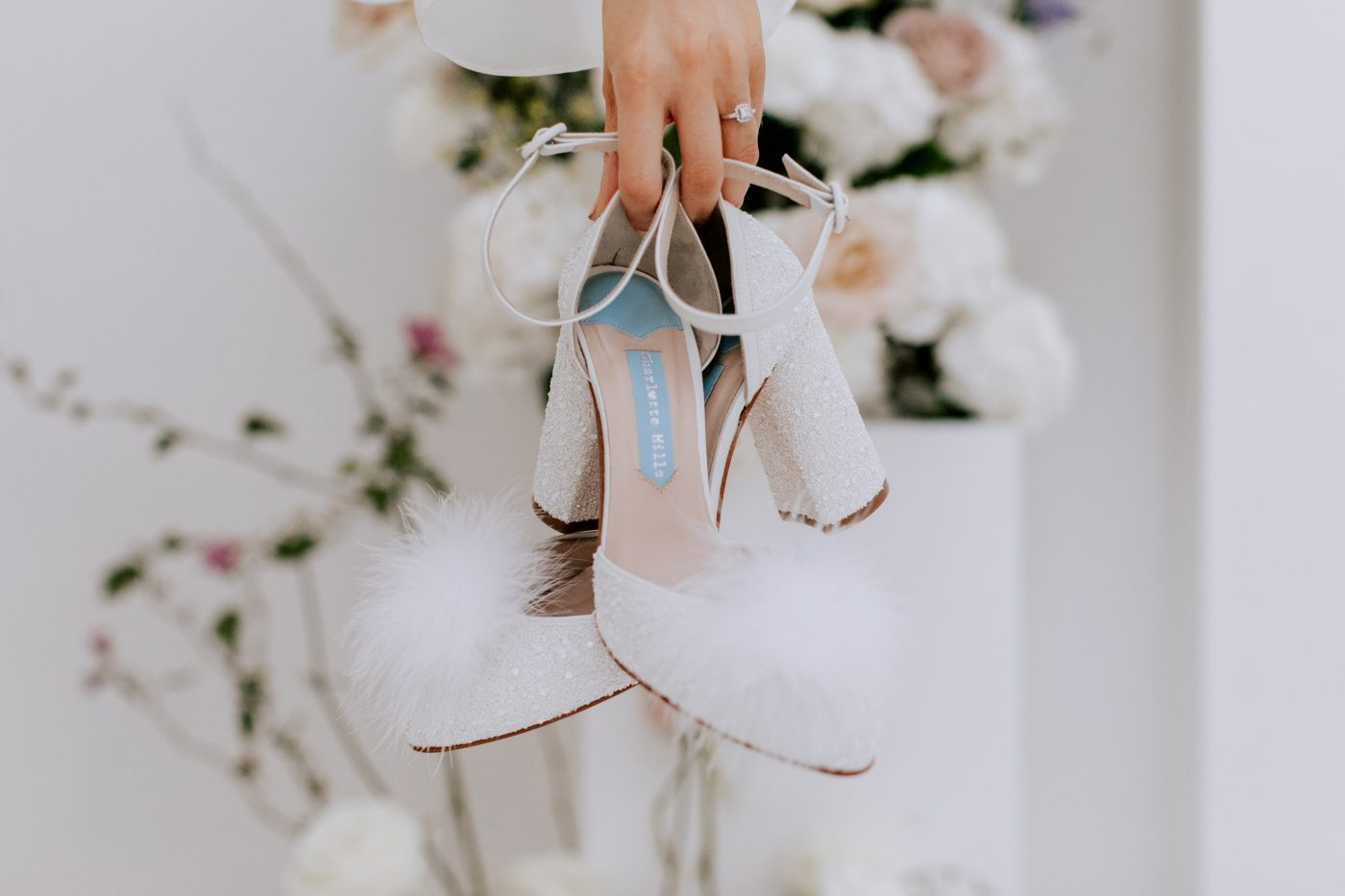 """<a href=""""https://charlottemills.com/collections/wedding-shoes/products/juniper-pearl"""" target=""""_blank"""" rel=""""noopener noreferrer"""">Juniper Pearl Pom Pom by Charlotte Mills</a> £265"""