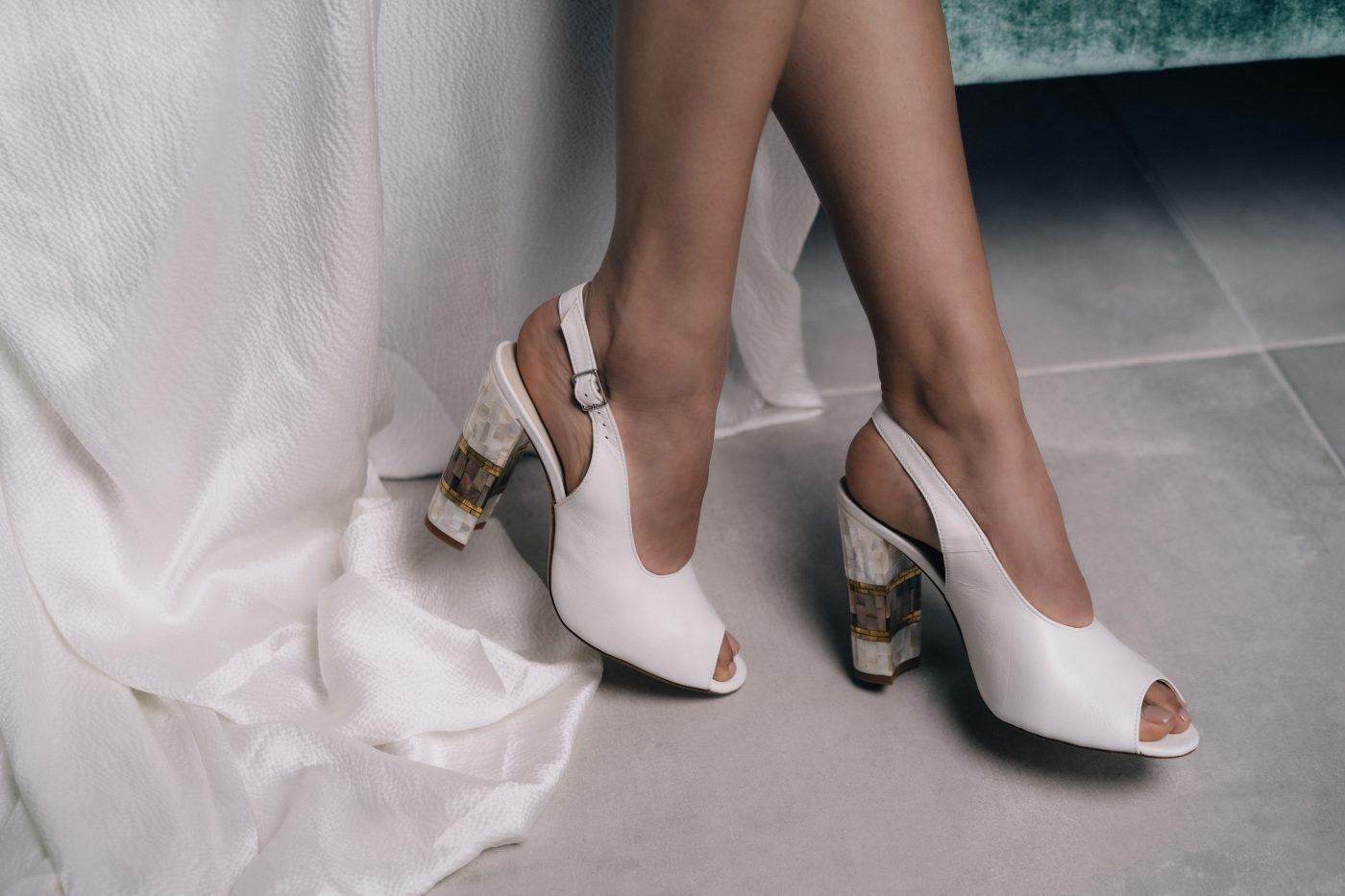 "<a href=""https://freyarose.com/collections/wedding-shoes/products/zara-white"" target=""_blank"" rel=""noopener noreferrer"">Zara White Peep Toe by Freya Rose</a> £495"