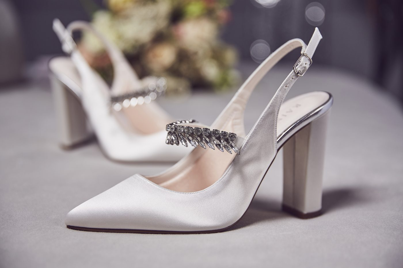 "<a href=""https://www.rainbowclub.co.uk/freya-slingback-wedding-shoes"" target=""_blank"" rel=""noopener noreferrer"">Freya Ivory by Rainbow Club</a> £99"