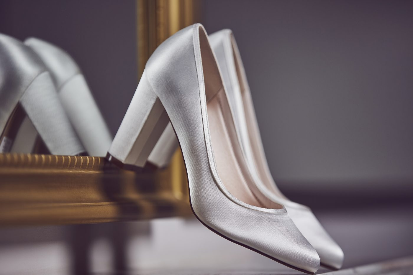 "<a href=""https://www.rainbowclub.co.uk/keily-simple-ivory-satin-wedding-shoes"" target=""_blank"" rel=""noopener noreferrer"">Keily Block Heel by Rainbow Club</a> £85"