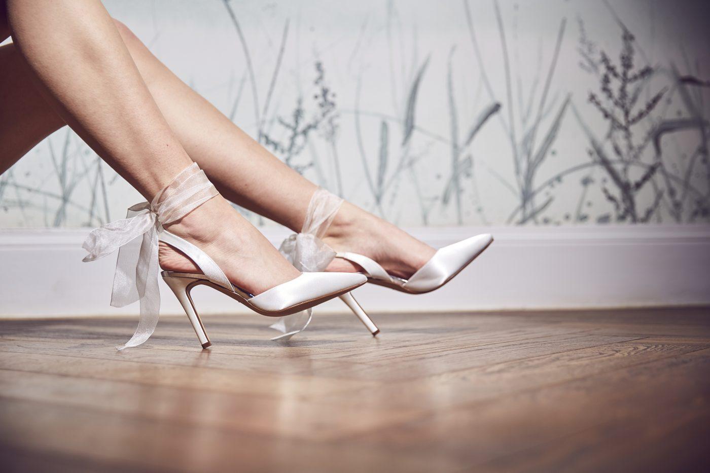 "<a href=""https://www.rainbowclub.co.uk/pandora-ribbon-bow-court-wedding-shoes"" target=""_blank"" rel=""noopener noreferrer"">Pandora Bridal Shoes by Rainbow Club</a> £85"